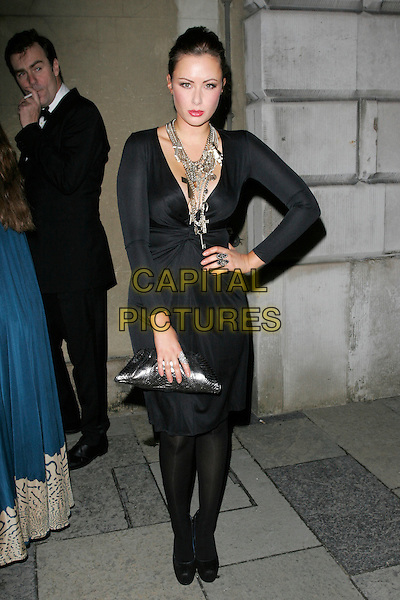CAMILLA AL FAYED.Chaos Point, in aid of NSPCC at the Banqueting House, London, England..November 18th, 2008 .full length black dress necklaces gold silver clutch bag purse rings tights .CAP/AH.©Adam Houghton/Capital Pictures.
