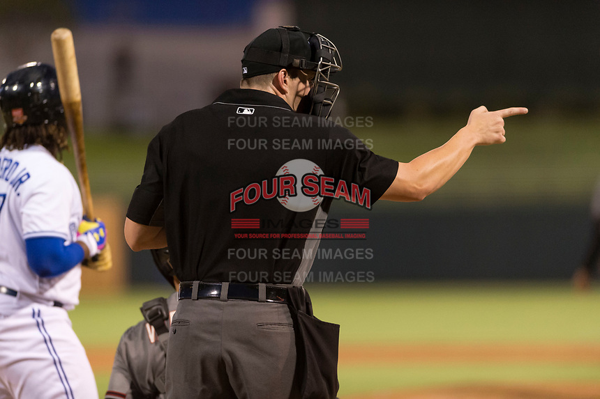 Home plate umpire Adam Beck calls a strike on Vladimir Guerrero Jr. (27) during the Arizona Fall League Fall Stars game at Surprise Stadium on November 3, 2018 in Surprise, Arizona. The AFL West defeated the AFL East 7-6 . (Zachary Lucy/Four Seam Images)