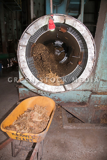 A rotating sorter separating palm kernels from empty fruit bunch fibers. The Sindora Palm Oil Mill, owned by Kulim, is green certified by the Roundtable on Sustainable Palm Oil (RSPO) for its environmental, economic, and socially sustainable practices. Johor Bahru, Malaysia
