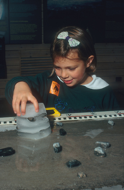 Girl looks at glacial ice experiment at Ice Museum Norsk Bremuseum, Norway
