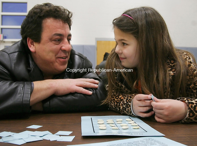 THOMASTON, CT 03/19/08- 031908BZ05- Lee Lombardo and his daughter Alexandra Lombardo, 8, talk over strategies to solve a problem while playing &quot;Go For the Beans, a subtraction game&quot; during family math night at Black Rock School in Thomaston Wednesday night.    <br /> Jamison C. Bazinet Republican-American