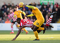 Lincoln City's John Akinde is fouled by Northampton Town's Aaron Pierre<br /> <br /> Photographer Chris Vaughan/CameraSport<br /> <br /> The EFL Sky Bet League Two - Lincoln City v Northampton Town - Saturday 9th February 2019 - Sincil Bank - Lincoln<br /> <br /> World Copyright &copy; 2019 CameraSport. All rights reserved. 43 Linden Ave. Countesthorpe. Leicester. England. LE8 5PG - Tel: +44 (0) 116 277 4147 - admin@camerasport.com - www.camerasport.com
