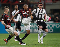 Calcio, Serie A: Milan vs Juventus. Milano, stadio San Siro, 9 aprile 2016. <br /> Juventus&rsquo; Mario Mandzukic, right, is challenged by AC Milan&rsquo;s Alex, center, and Juraj Kucka, during the Italian Serie A football match between AC Milan and Juventus at Milan's San Siro stadium, 9 April 2016.<br /> UPDATE IMAGES PRESS/Isabella Bonotto