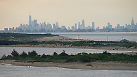 SANDY HOOK, NJ - JUNE 26: People visit the beach of Sandy Hook front of the skyline of lower Manhattan on June 26, 2020 in Sandy Hook, New Jersey.The State continue it's reopening while the U.S. hit record for new coronavirus cases. (Photo by Kena Betancur/ VIEWpress via Getty Images)