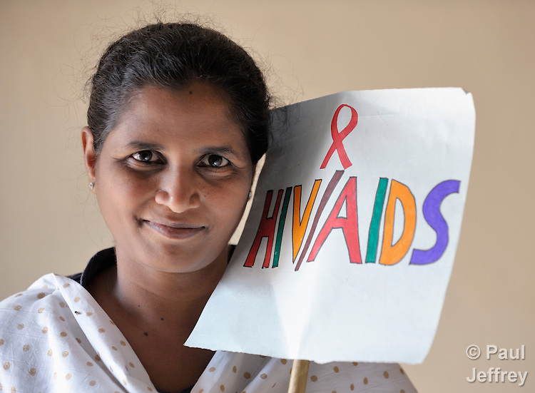 B. Jeyakumari takes to the streets of India to demand an end to stigma and discrimination against people living with HIV and AIDS. She is an HIV positive woman who is a member of the Hope Arpana Positive People Effective Network in Guntur, Andhra Pradesh, India. (See Special Instructions below.)