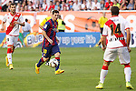 Rayo Vallecano´s Baptistao (L) and Barcelona´s Leo Messi during La Liga match between Rayo Vallecano and Barcelona at Vallecas stadium in Madrid, Spain. October 04, 2014. (ALTERPHOTOS/Victor Blanco)