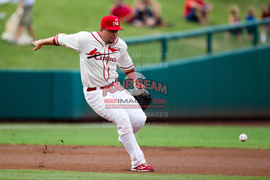 Zack Cox (7) of the Springfield Cardinals tries to field a ball during a game against the Northwest Arkansas Naturals and the Springfield Cardinals at Hammons Field on July 30, 2011 in Springfield, Missouri. Springfield defeated Northwest Arkansas 11-5. (David Welker / Four Seam Images)