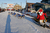 Wednesday March 14, 2007   ----   Mitch Seavey runs down the finish chute to the burl arch finish line as he arrives at the finish line in Nome in 9th place.