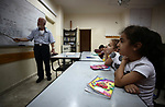 Samaritan tutor Ragheb Mfarrej ,78, teaches kids the ancient Samaritan language, at Mount Gerizim near the West Bank city of Nablus, on October 7, 2018. The kids start learning Hebrew ancient language on their 6 years old, daily for a full round year. Today the ancient hebrew used by the samaritens in prayers, wedding, parties and circumcision. every samaritans males and females should learn this languge at 6 years, so he she can joine the real samaritan life. Photo by Ayman Ameen