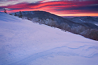 """RIDGE ON FIRE"" -- A clearing winter storm, fresh snow covering the landscape, moisture in the air, and fog in the valleys. Perfect conditions for a great sunrise. Mother Nature did not disappoint on this wonderful morning at the Roan Highlands. Grassy Ridge is in the foreground and the photograph was taken near Round Bald along the Appalachian Trail."