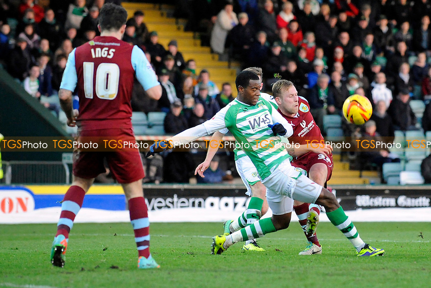 Scott Arfield of Burnley gets in a cross under pressure - Yeovil Town vs Burnley - Sky Bet Championship Football at Huish Park, Yeovil, Somerset - 11/01/14 - MANDATORY CREDIT: Denis Murphy/TGSPHOTO - Self billing applies where appropriate - 0845 094 6026 - contact@tgsphoto.co.uk - NO UNPAID USE