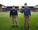 Royal Marines with the matchball after abseiling from the roof of the stand