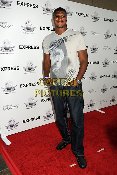 "CALAIS CAMPBELL.Matt Leinart's 4th Annual ""Bowling With The Stars"" Event held at Lucky Strike Lanes, Hollywood, California, USA..July 15th, 2010.full length t-shirt print hand sin pockets  grey gray jeans denim.CAP/ADM/BP.©Byron Purvis/AdMedia/Capital Pictures."