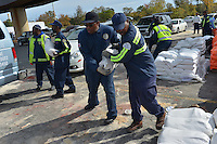October 27, 2012 (Washington, DC)  D.C. Department of Public Works (DPW) employees distribute sandbags to residents in preparation for Hurricane Sandy  (Photo by Don Baxter/Media Images International)