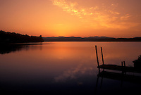 AJ4513, sunrise, sunset, lake, Silhouette of a dock on Lake Bomoseen at sunrise in Hydeville in Rutland County in the state of Vermont.