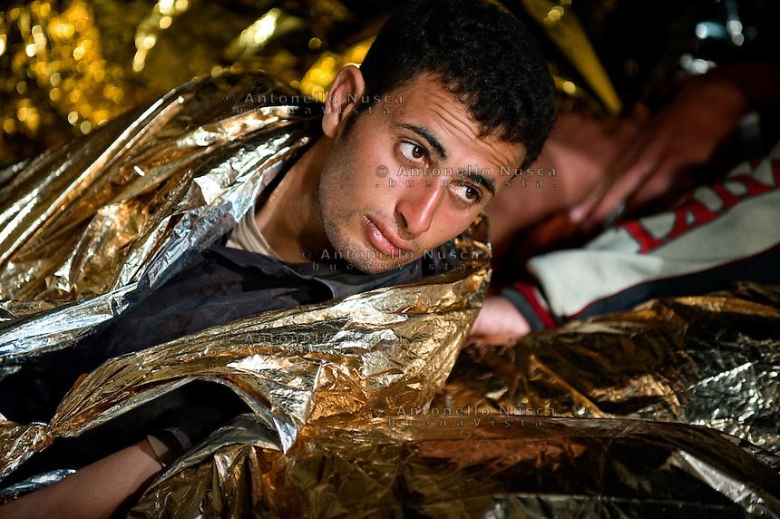 Alcuni clandestini provenienti dall'Africa vengono soccorsi da una motovedetta della Capitaneria di Porto al largo dell'isola di Lampedusa..An illegal immigrant rescue by Italian Coast Guard