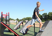 NWA Democrat-Gazette/DAVID GOTTSCHALK Charlie Nunn, 13, works his way Monday, August 12, 2019, through the quintuple steps at the Fitcore Extreme Obstacle Course in Farmington. The new course features many obstacles to challenge and increase stability, balance and upper and lower body strength.