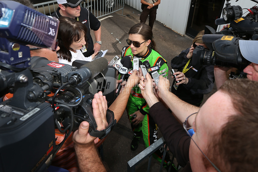 Mar. 3, 2013; Avondale, AZ, USA; NASCAR Sprint Cup Series driver Danica Patrick is interviewed by the media after crashing during the Subway Fresh Fit 500 at Phoenix International Raceway. Mandatory Credit: Mark J. Rebilas-