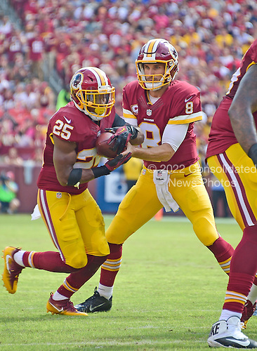 Washington Redskins quarterback Kirk Cousins (8) hands off to Washington Redskins running back Chris Thompson (25) in first quarter action against the Cleveland Browns at FedEx Field in Landover, Maryland on October 2, 2016.<br /> Credit: Ron Sachs / CNP