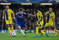 Oscar of Chelsea holds off Nosa Igiebor of Maccabi Tel Aviv during the UEFA Champions League match between Chelsea and Maccabi Tel Aviv at Stamford Bridge, London, England on 16 September 2015. Photo by Andy Rowland.