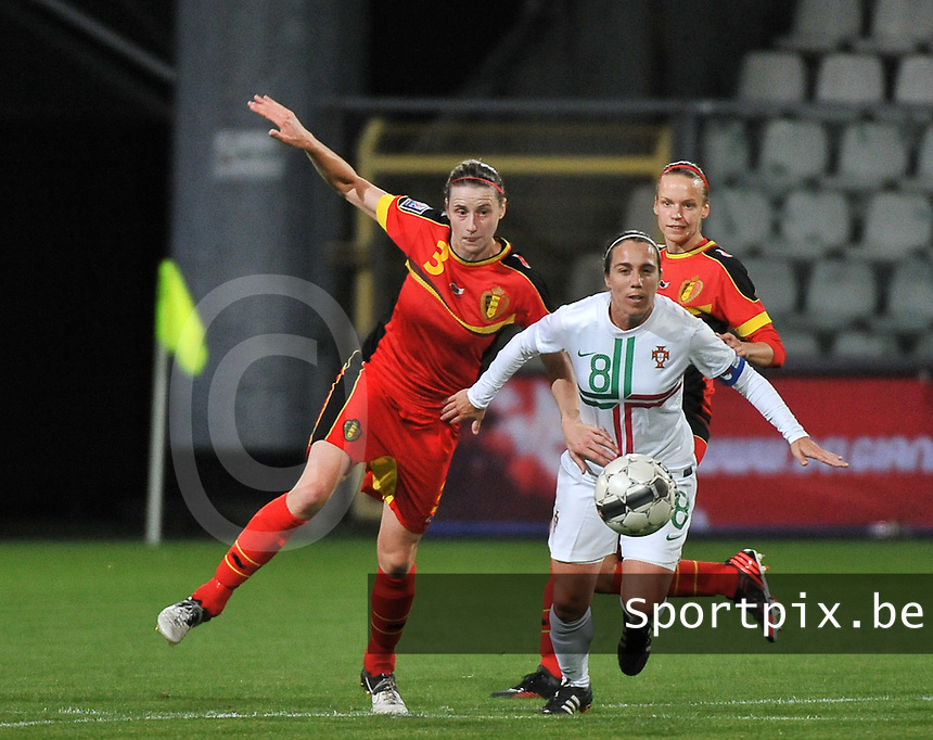 20131031 - ANTWERPEN , BELGIUM : Belgian Heleen Jaques (3) pictured in a duel with Portugese Edite Fernandes (8)  during the female soccer match between Belgium and Portugal , on the fourth matchday in group 5 of the UEFA qualifying round to the FIFA Women World Cup in Canada 2015 at Het Kiel stadium , Antwerp . Thursday 31st October 2013. PHOTO DAVID CATRY