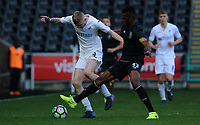 SWANSEA, WALES - MARCH 25: Oli McBurnie of Swansea City is challenged by Chidozie Awaziem of Porto during the Premier League International Cup Semi Final match between Swansea City and Porto at The Liberty Stadium on March 25, 2017 in Swansea, Wales. (Photo by Athena Pictures)