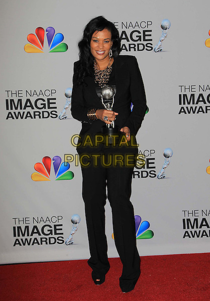 Beverly Bond.44th NAACP Image Awards - Press Room Held At The Shrine Auditorium, Los Angeles, California, USA, .1st February 2013..full length black suit award trophy .CAP/ADM/KB.©Kevan Brooks/AdMedia/Capital Pictures.