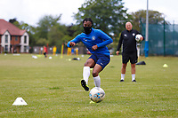 23rd May 2020; United Select HQ, Richings Sports Park, Iver, Bucks, England, United Select HQ exclusive Photo shoot session; Lucas Sinclair, former Millwall academy, wearing a neckwarmer to cover mouth during shooting drills with United Select Director of Football  Tristan Lewis  observing