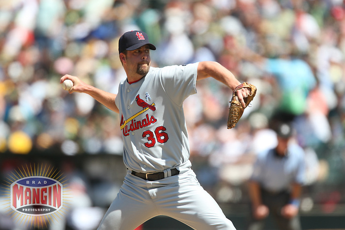 OAKLAND, CA - June 17:  Russ Springer of the St. Louis Cardinals pitches during the game against the Oakland Athletics at the McAfee Coliseum in Oakland, California on June 17, 2007.  The Cardinals defeated the Athletics 10-6.  Photo by Brad Mangin