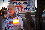 Dec. 2, 2009 -- PHOENIX, AZ: JOAN KROLL, a member of Grandmothers for Peace from Sun City West, AZ, protests the troop increase in Afghanistan on a street corner in Phoenix Wednesday. About 50 people from across the Phoenix metropolitan area attended the protest and vigil against the troop increase President Barack Obama announced on Dec. 1. Photo by Jack Kurtz