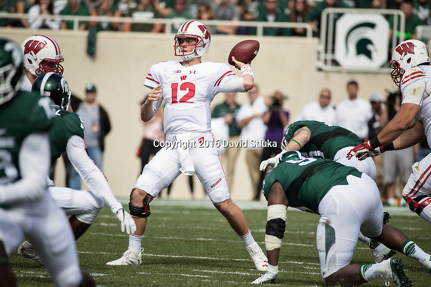 Wisconsin Badgers quarterback Alex Hornibrook (12) throws a pass during an NCAA college football game against the Michigan State Spartans Saturday, September 24, 2016, in East Lansing, Michigan. The Badgers won 30-6. (Photo by David Stluka)