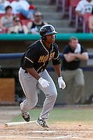 Harold Riggins #35 of the Modesto Nuts bats against the High Desert Mavericks at Stater Bros. Stadium on June 29, 2013 in Adelanto, California. Modesto defeated High Desert, 7-2. (Larry Goren/Four Seam Images)