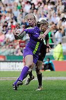 Natasha Hunt of England is tackled during the iRB Marriott London Sevens at Twickenham on Sunday 13th May 2012 (Photo by Rob Munro)
