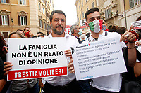 Lega senator Matteo Salvini  shows a banner with the inscription 'the family is not a crime of opinion' together with a gay man who is against the law, during the demonstration against the trans homophobia law proposed in parliament.  Rome (Italy), July 16th 2020<br /> Foto Samantha Zucchi Insidefoto
