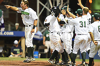 Jamestown Jammers celebrate a walk off in including Michael Suchy (35), Deybi Garcia (7), Jonathan Minier (28) during a game against the Vermont Lake Monsters on July 12, 2014 at Russell Diethrick Park in Jamestown, New York.  Jamestown defeated Vermont 3-2.  (Mike Janes/Four Seam Images)