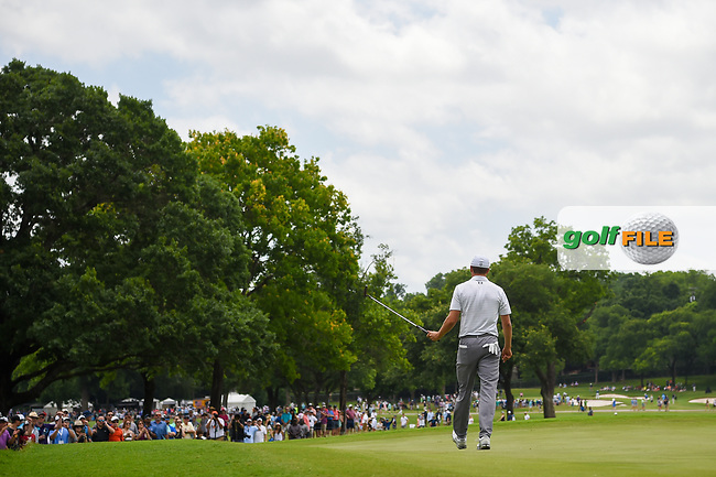 Jordan Spieth (USA) sinks his birdie putt on 2 with a packed hometown gallery on hand during round 3 of the 2019 Charles Schwab Challenge, Colonial Country Club, Ft. Worth, Texas,  USA. 5/25/2019.<br /> Picture: Golffile | Ken Murray<br /> <br /> All photo usage must carry mandatory copyright credit (© Golffile | Ken Murray)