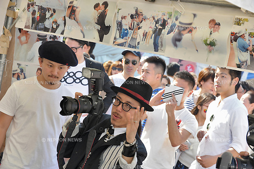 Singapore born fashion photographer photographer Leslie Kee at the Tokyo Rainbow Pride Festival in Tokyo, Japan on Sunday April 26, 2015. The annually organized event celebrates diversity, and aims to raise awareness for equal rights of sexual minorities.<br /> <br /> The festival features a colorful parade and a festival with food, fashion and health care stalls, as well as musical performances, at Yoyogi Park.