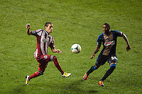 Eric Avila (15) of CD Chivas USA is marked by Raymon Gaddis (28) of the Philadelphia Union. The Philadelphia Union defeated the CD Chivas USA 3-1 during a Major League Soccer (MLS) match at PPL Park in Chester, PA, on July 12, 2013.