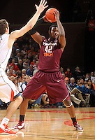 Virginia Tech forward C.J. Barksdale (42) handles the ball  during the game Tuesday in Charlottesville, VA. Virginia defeated Virginia Tech73-55.
