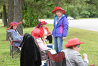 Pattie Heitzman, a member of the Red Hat Hotties, visits with other members Wednesday, May 20, 2020, outside in front of the Rogers Adult Wellness Center in Rogers. The social group would normally meet inside the center but it is closed do to the covid-19 pandemic. The group has decided to meet every other Wednesday for lunch and a visit outside the center. Check out nwaonline.com/200521Daily/ and nwadg.com/photos for a photo gallery.<br /> (NWA Democrat-Gazette/David Gottschalk)