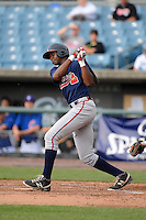 Shortstop Montrell Marshall (22) of South Gwinnett High School in Snellville, Georgia playing for the Atlanta Braves scout team during the East Coast Pro Showcase on August 2, 2013 at NBT Bank Stadium in Syracuse, New York.  (Mike Janes/Four Seam Images)
