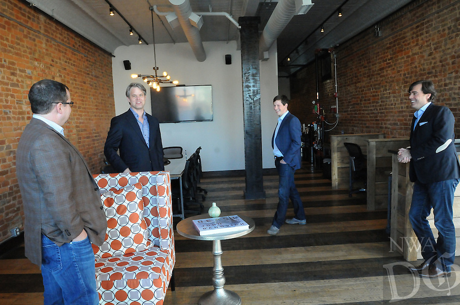 NWA Democrat-Gazette/FLIP PUTTHOFF <br /> BUSINESS TEAM<br /> The NewRoad Ventures team talks in their offices on Tuesday Feb. 10 2015 in downtown Bentonville. They are Clete Brewer, managing director; (from left) Steve Brooks, managing director; Kennon Largent, senior associate and Jeremy Wilson, CEO.