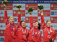 European Championships Fencing 2010 / Fecht Europameisterschaft 2010 in Leipzig - Competition Championat d'europe - im Bild: the new European Champion womens epee team - the Polish Team Magdalena Piekarski, Ewa Nelip, Malgorzata Stroka and Danuta Dmowska-Andrejuk with their Gold medals . Foto: Norman Rembarz..Norman Rembarz , Autorennummer 41043728 , Augustenstr. 2, 04317 Leipzig, Tel.: 01794887569, Hypovereinsbank: BLZ: 86020086, KN: 357889472, St.Nr.: 231/261/06432 - Jegliche kommerzielle Nutzung ist honorar- und mehrwertsteuerpflichtig! Persönlichkeitsrechte sind zu wahren. Es wird keine Haftung übernommen bei Verletzung von Rechten Dritter. Autoren-Nennung gem. §13 UrhGes. wird verlangt. Weitergabe an Dritte nur nach  vorheriger Absprache..