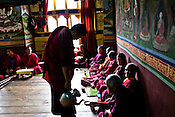 A Buddhist lama pours tea for nuns during a tea break inside the Ramtanka Temple in Paro, Bhutan. Photo: Sanjit Das/Panos