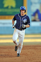 Asheville Tourists designated hitter Tom Murphy #9 rounds the bases after homering during a game against the West Virginia Power at McCormick Field on April 13, 2013 in Asheville, North Carolina. The Power won the game 14-9. (Tony Farlow/Four Seam Images).