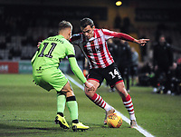 Lincoln City's Harry Toffolo vies for possession with Forest Green Rovers' George Williams<br /> <br /> Photographer Andrew Vaughan/CameraSport<br /> <br /> The EFL Sky Bet League Two - Lincoln City v Forest Green Rovers - Saturday 3rd November 2018 - Sincil Bank - Lincoln<br /> <br /> World Copyright © 2018 CameraSport. All rights reserved. 43 Linden Ave. Countesthorpe. Leicester. England. LE8 5PG - Tel: +44 (0) 116 277 4147 - admin@camerasport.com - www.camerasport.com
