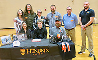 Westside Eagle Observer/SUSAN HOLLAND<br /> Caleb Brown poses with family and coaches after signing Thursday, March 5, to run track and play football with the Warriors at Hendrix College this fall. Celebrating with Caleb are his mother and father, Cielito Brown and James Brown, and cousins Megan and Travis Day (back row), his grandmother Evelyn Brown, uncle Jon Brown, track coach Rick Rachel and football coach Kelby Bohannon.