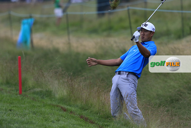James Hahn (USA) precariously balanced as he chips onto the 8th green during Friday's Round 1 of the 2016 U.S. Open Championship held at Oakmont Country Club, Oakmont, Pittsburgh, Pennsylvania, United States of America. 17th June 2016.<br /> Picture: Eoin Clarke | Golffile<br /> <br /> <br /> All photos usage must carry mandatory copyright credit (&copy; Golffile | Eoin Clarke)