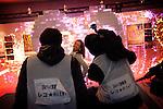 (Eng) Yokohama, March 6 2010 - At the Tokyo Girls Collection, models and TV stars are parading for fast-fashion brands in front of 20 000 teenagers. A Japanese TV crew playing before the show.<br /> <br /> (Fr) Yokohama, 6 mars 2010 - A la Tokyo Girl Collection, des mannequins et stars de la television defilent pour des marques grand-public devant 20 000 adolescentes. Des journalistes japonais posent devant les murs colores de l'entree de l'evenement.