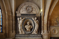 Tomb of Henri IV, king of France and Navarre 1589-1610, with stone bust after marble sculpture by B Tremblay, and virtues in resin, 1992, after tomb of Christophe de Tou, 1840, in the crypt of the Basilique Saint-Denis, Paris, France. The basilica is a large medieval 12th century Gothic abbey church and burial site of French kings from 10th - 18th centuries. Picture by Manuel Cohen